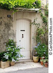 French front door surrounded by flowers