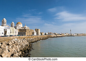 Blue sky, seafront and the Cathedral Campo del Sur in Cadiz, Spain