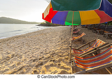 Beach chairs and colorful umbrellas on the beach in sunny...