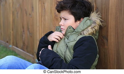 Young boy, kid in winter clothes trying to warm - Handsome...