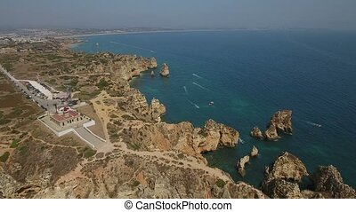 Aerial. Ponta de Piedade flight over a lighthouse and bay....