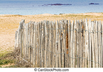 wooden palisade by the sea