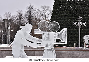 Ice sculpture videographer with a camera