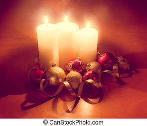 Candles with christmas balls