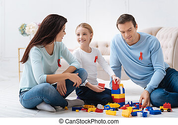 Nice close knit family playing with meccano set - Games are...