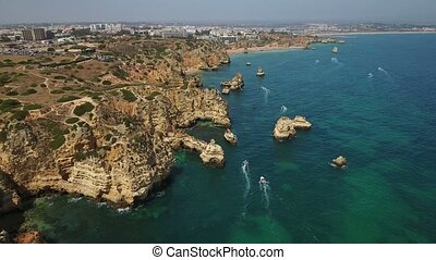 Aerial. Shooting in the sky over the bay Ponta de Piedade....