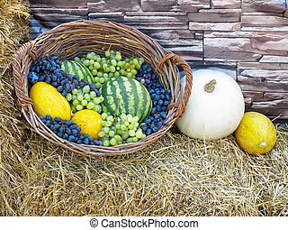 fruit basket with melon, watermelon grapes,on straw - fruit...
