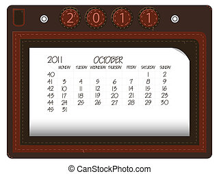 october 2011 leather calendar against white background,...