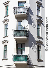 old house with balconies and satellite dish in Berlin Kreuzberg