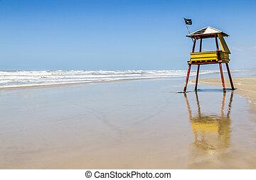 Lifeguard towe and waves and blue sky at Balnearios de...
