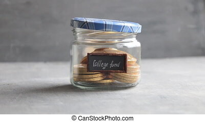 college fund idea, money saving for education in the glass...