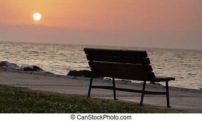 Bench by sea at sunset - Nature
