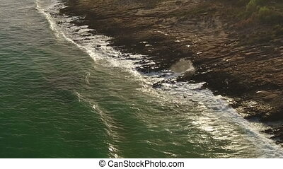 Aerial. Waves filmed from the sky in slow motion. Portugal.