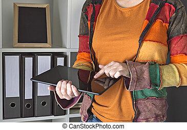 Female designer using digital tablet in the office.