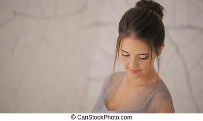 Beautiful young girl with wedding bouquet, close-up shot....