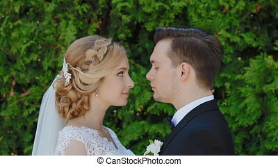 Bride and groom outdoor look at each other - Happy bride and...