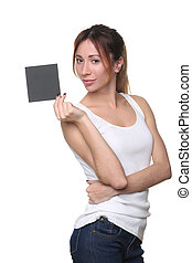 Woman posing and holding black card. Close up. White...