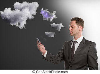 Cloud sync concept - Handsome young man holding smartphone...