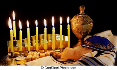 Jewish holiday hannukah symbols Lighting Hanukkah Candles...