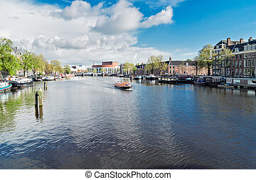 Amstel canal, Amsterdam - embankments of Amstel canal with...