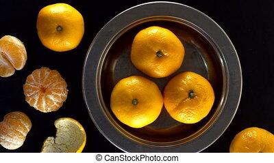 Fresh tangerines on black background. - Fresh tangerines on...