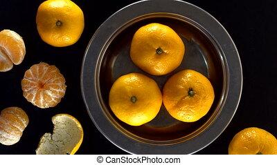 Frash tangerines on black background. - Frash tangerines on...