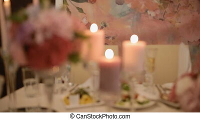 View of the well decorated wedding table with flowers and...
