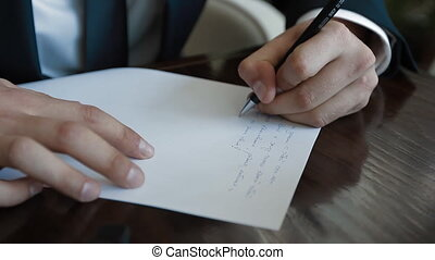 Man write a paper letter - Southpaw man write a paper...