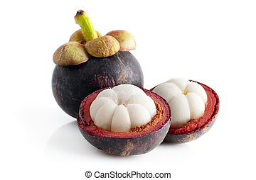 Mangosteen fruit and cross section showing the thick purple...