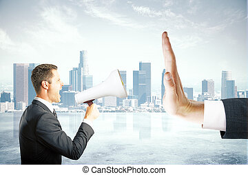 Protest concept - Angry caucasian businessman with megaphone...