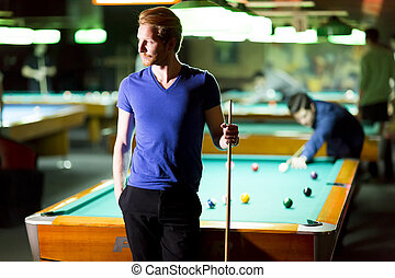 Billiards - Portrait of a young man playing snooker
