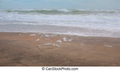 Big waves during a storm in the coast, sea foam