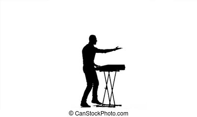 Piano playing. Man in half-turn. Silhouette. Slow motion