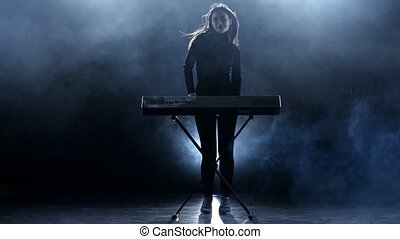 Musician woman playing the piano. Studio. Smoke - Musician...