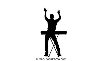 Man dj dancing and singing at the piano sounds. Silhouette -...