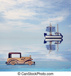 A toy car on a blue wooden surface and a toy sailboat at...