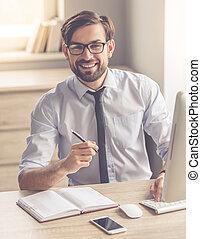 Handsome businessman working
