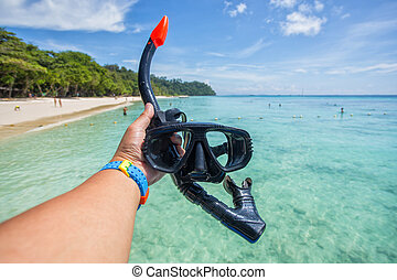 Hand man holding snorkel goggles