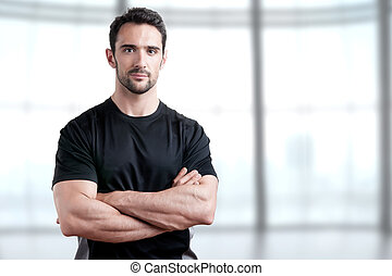 Personal Trainer - Personal trainer with is arms crossed, in...