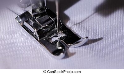 Sewing machine makes a stitch of black thread. Slow motion -...
