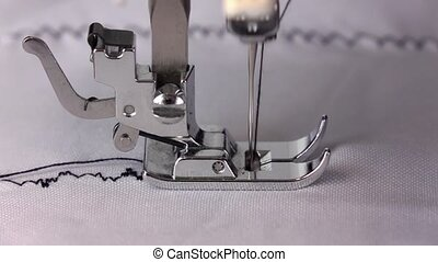 Work of the sewing machine, side view. Slow motion - Work of...