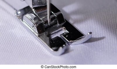 Sewing screening process. Front view. Close up. Slow motion