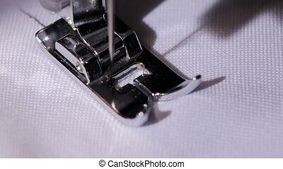 Sewing machine sews a straight stitch. Close. Slow motion -...