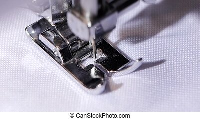 Performing sewing machine original seam. Close. Slow motion...