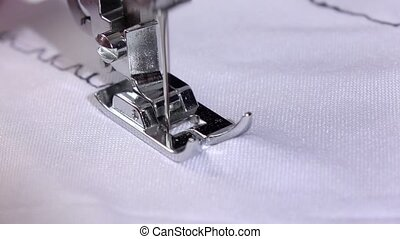 Seam with different tension of a black thread. Slow motion -...