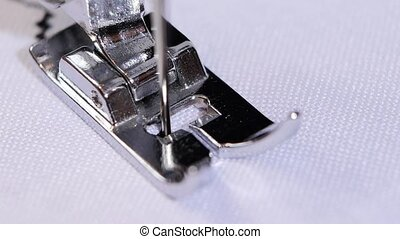 The sewing machine sews a decorative stitch in slow motion -...