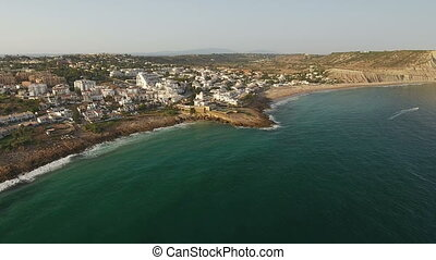 Aerial. Tourist village of Luz beach, with views of the sky...