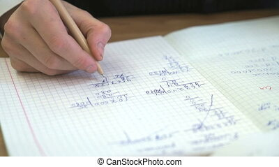 Student writes the text in the exercise book - Student...