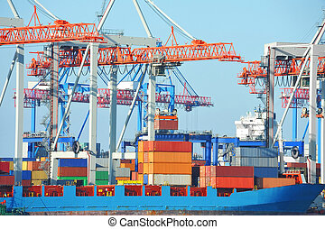 Port cargo crane, ship and container over blue sky...