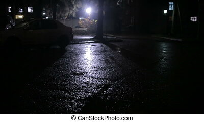 rain in a dark courtyard at night, follow